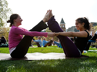 Students participating in a yoga class on Bascom Hill.