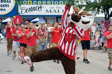 Photo of Bucky Badger leading the UW Marching band during UW–Madison Day at the Wisconsin State Fair.
