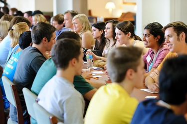 Photo of incoming transfer students participating in a networking activity during a Transfer Student Retreat event .