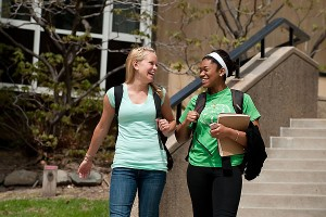 Undergraduate Melanie Zaferos (at left), a first-year student studying elementary education and dance, and her friend Gina Obiakor walk down stairs near Van Vleck on campus.