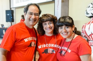 Photo of a student and her family during a Parents' Weekend football tailgate party.