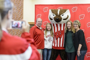 UW–Madison students and their family members pose with UW mascot Bucky Badger during a Family Weekend event.