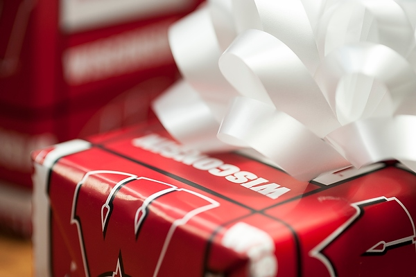 A present wrapped in Wisconsin gift wrap.
