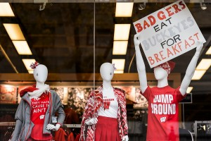 Wisconsin-themed attire and pro-badger signs are displayed in a University Book Store window before the start of a football game between the Wisconsin Badgers and the Ohio State University (OSU) Buckeyes at Camp Randall Stadium at the University of Wisconsin-Madison on Oct. 15, 2016. (Photo by Jeff Miller/UW-Madison)