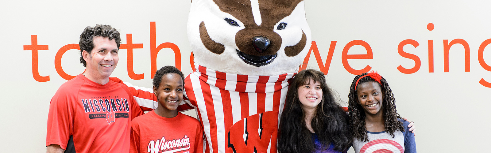 UW students and their families get their photo taken with UW mascot Bucky Badger while taking part in a Parents' Weekend festival