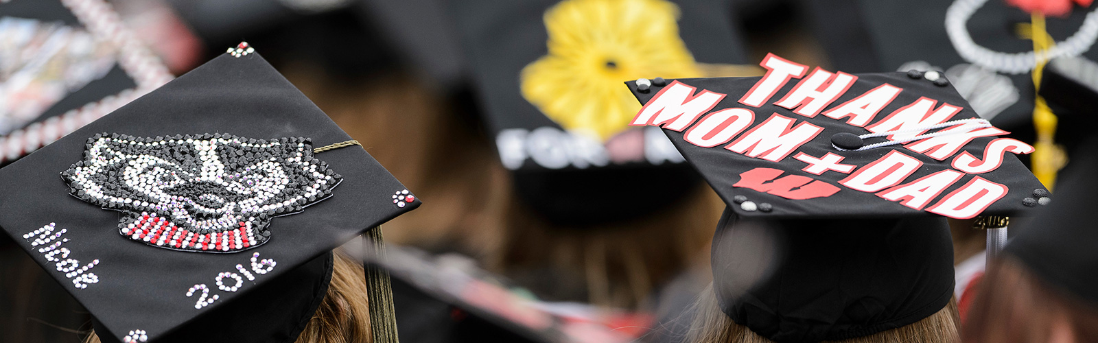 Graduates put their creativity on display with decorated and Wisconsin-themed mortarboards during UW–Madison's spring commencement ceremony at Camp Randall Stadium.