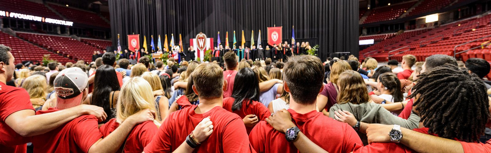 "Students link arms and sing ""Varsity"" at the end of the Chancellor's Convocation for New Students."