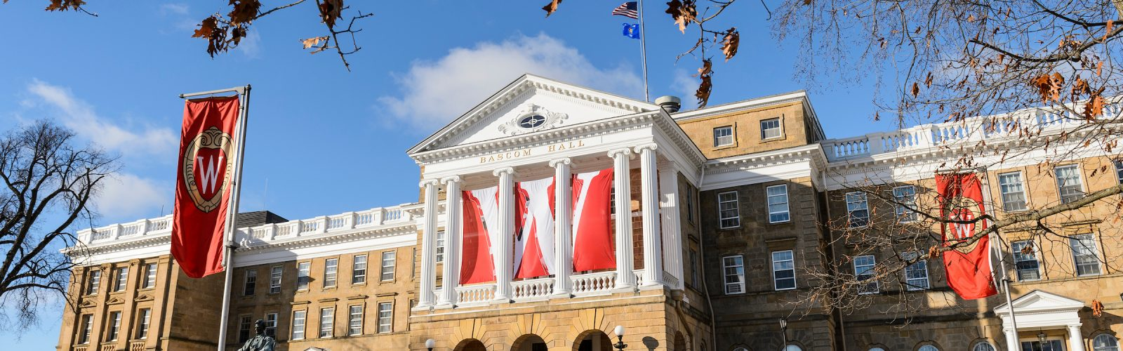 W banners hang from the columns of Bascom Hall.