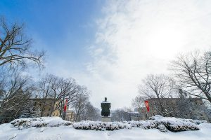 A view of the Abraham Lincoln statue, snow-covered, on top of Bascom Hill.