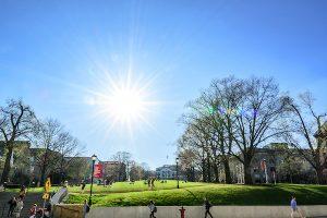 Students enjoy a warm spring day on Bascom Hill.
