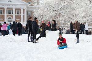 Students converge on Bascom Hill to play in the fresh snow and sled down portions of the hill.
