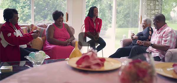 """A still from the short film titled """"Why I Love UW,"""" showing the Gee family at home."""